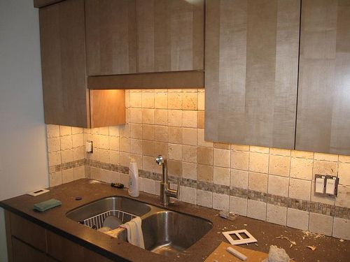 tumbled stone backsplash is being installed in clifton kitchen